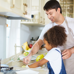 Image of Father/daughter doing dishes